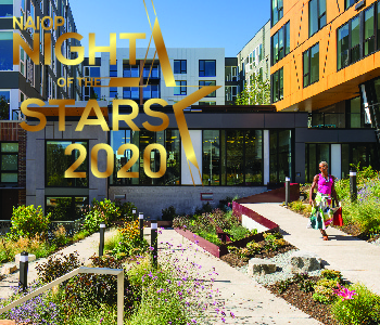 Woman walking in front of Jackson Apts with NAIOP Night of the Stars logo